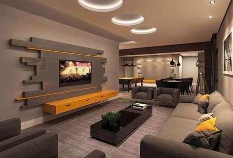 28. Poltronas para sala de tv em tom cinza e tapete de tecido. Fonte: Revista Viva Decora