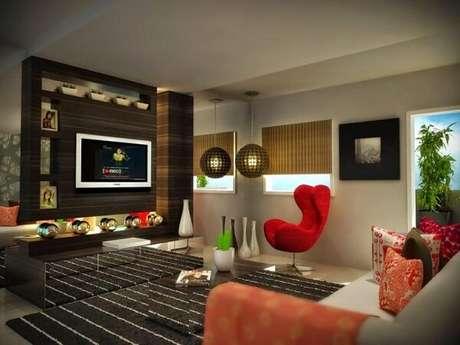 33. Poltronas para sala de tv em tom vermelho. Fonte: Total Construção