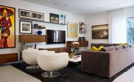 70. Poltronas para sala de tv giratórias e em formato arredondado. Fonte: Pinterest