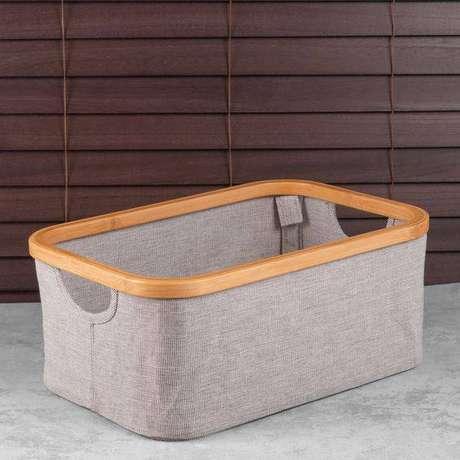 45. A simplicidade do cesto organizador é sua principal vantagem. Foto: Etna