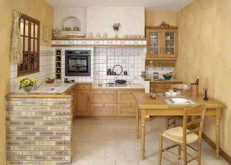 52. Armário de madeira para cozinha com marcenaria clara. Fonte: Decor Ideias Casa
