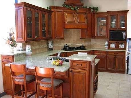 28. Modelo de armário de madeira para cozinha planejado. Fonte: Residence Style