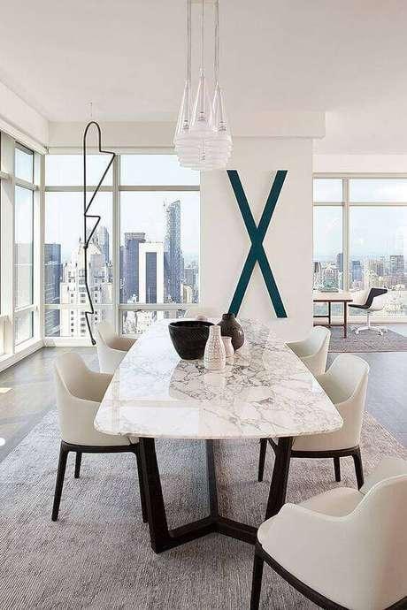 20. Uma boa mesa de mármore caminha no liminar entre o delicado e o chamativo. Foto: Design You Trust