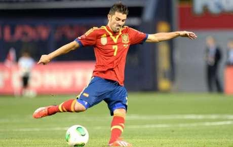 David Villa em ação pela seleção espanhola, onde conquistou uma Eurocopa e uma Copa do Mundo (AFP)