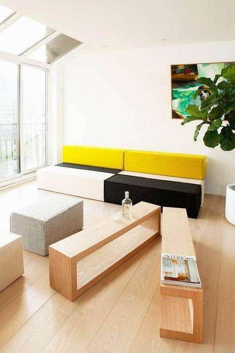 50. Decoração para sala com sofá sem braço moderno e colorido – Foto: Archzine