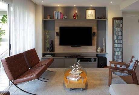 2. Decoração de sala de estar com poltronas de couro – Projeto: Cris Paola