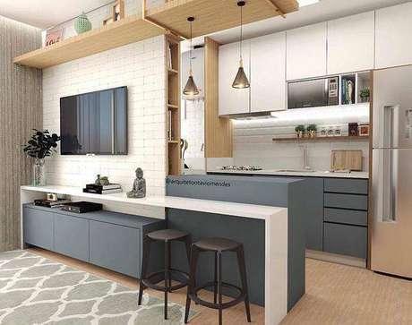 2. A cozinha cinza compacta chama a atenção por ser otimizada. Foto: 4Style Interiores