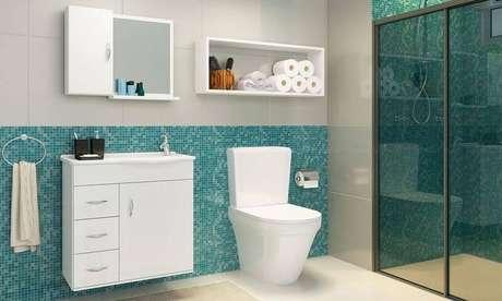 25. Banheiro com pastilhas azul Tiffany. Projeto de Lojas KD