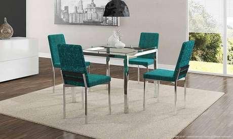 57. Cadeiras azul Tiffany em sala de jantar. Projeto de Lojas KD