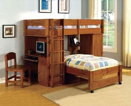 47. Modelo de beliche com escrivaninha de madeira maciça e cama extra