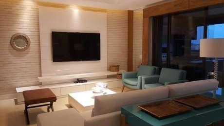 56. Sala de estar com poltronas azul Tiffany. Projeto de Lucio Nocito