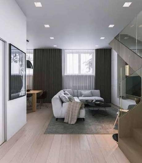 23. Ambiente integrado com piso flutuante em tom claro. Fonte: Pinterest