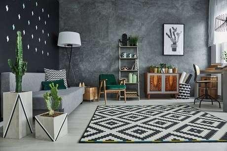 6. A parede de cimento queimado é uma tendência de decoração que pode mudar o visual da sua sala decorada – Foto: Habitissimo