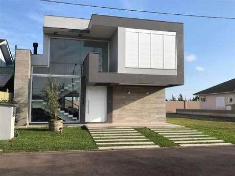 21. Modelo de casas lindas e modernas com paredes de vidro – Foto: Compplex Arquitetura