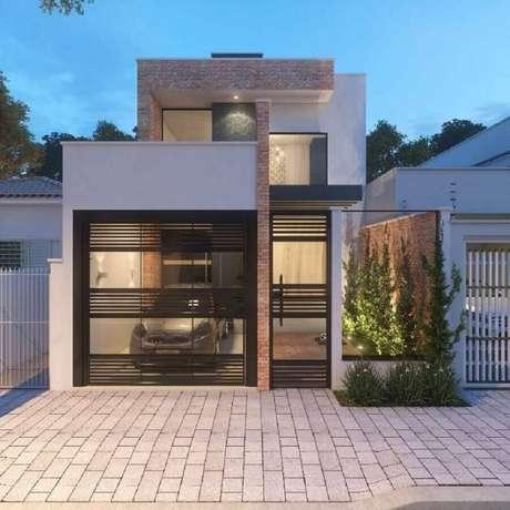 5. Casas pequenas e lindas também podem contar com um delicado jardim na fachada – Foto: Adriana Mello Arquitetura