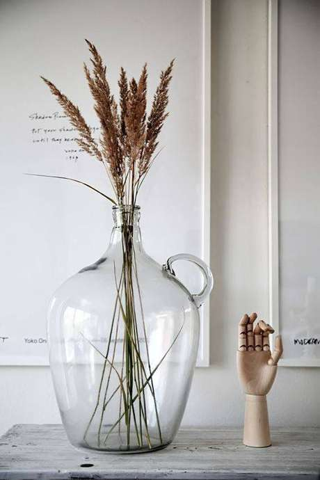 44. As flores secas em garrafa é algo muito comum. Foto: Casa Vogue