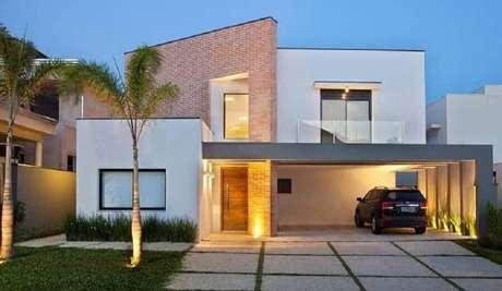 59. Modelos de casas lindas e simples com detalhe em tijolinho à vista na fachada – Foto: Dicas Decor