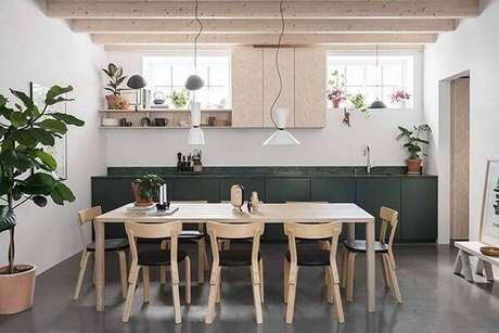 12. Cozinha aberta com bancada feita de granito verde ubatuba. Fonte: Pinterest