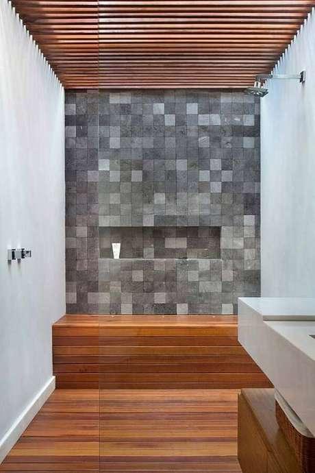 24. A área do banho recebeu um acabamento especial com pedra miracema. Fonte: Pinterest