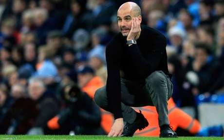 Guardiola tem contrato com o City até 2021 (Foto: LINDSEY PARNABY / AFP)