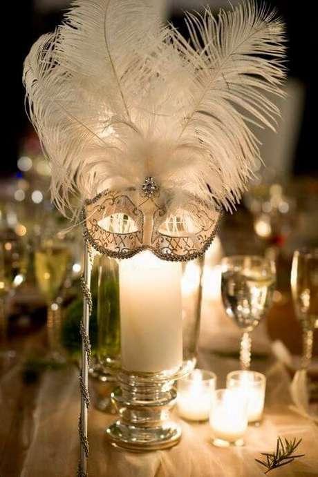 18. Velas e plumas também são ótimas opções para decorar sua festa – Via: Pinterest