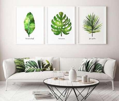 59. Os quadros grandes para sala de estar trazem um toque da natureza para dentro do ambiente. Fonte: Bugre