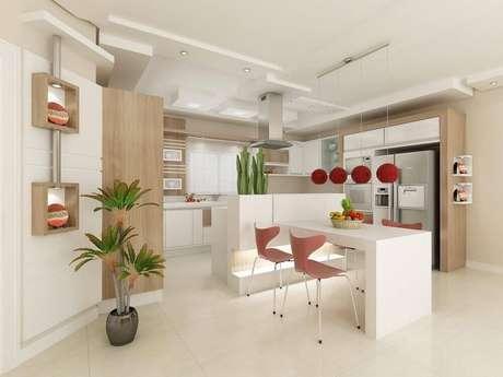 23. Cozinha decorada com nichos com luminária para cozinha e luminárias vermelhas