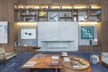21. Livros e velas deixam as mesas de centro com personalidade. Projeto por Anexo Arquitetura.