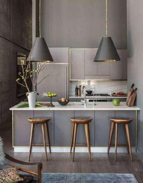 11. Decoração contemporânea com luminária para cozinha americana