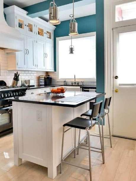 12. Linda decoração com modelo moderno de luminária para cozinha
