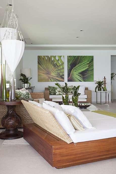 65. Quadros grandes para sala e sofá de sisal. Projeto por Korman Arquitetos
