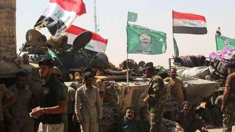 As milícias xiitas apoiadas pelo Irã na força de Mobilização Popular desempenharam um papel fundamental na guerra contra o Estado Islâmico.