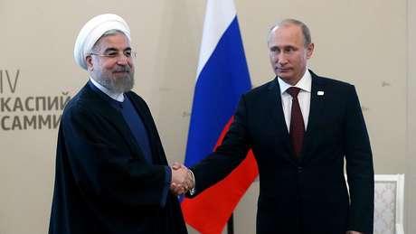 Tanto Hassan Rouhani como Vladimir Putin tentam expandir suas esferas de influência no Oriente Médio e se contrapor ao poder dos EUA na região