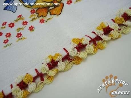 18. Bico de crochê para pano de prato em formato de flor. Foto de Aprendendo Croche