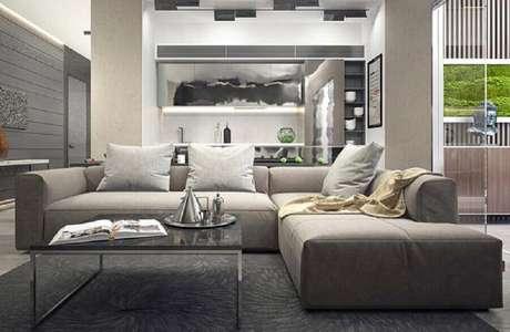 40. Design moderno de sofá de canto cinza para sala contemporânea – Foto: Pinterest
