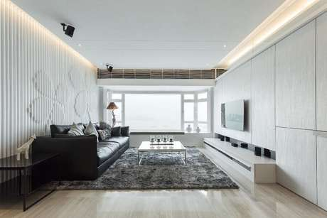 29. Rack com painel para sala branca e cinza decorada com revestimento 3D – Foto: UniLED