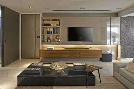 44. Rack com painel suspenso para decoração de sala moderna – Foto: Escritório Bellini