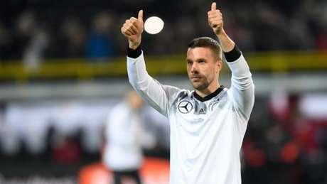 Podolski na despedida da seleção alemã: atacante marcou 49 gols pelo Die Mannschaft (Foto: AFP)