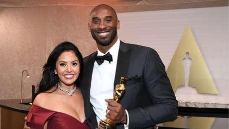 Koe e a esposa Vanessa, na cerimônia do Oscar (Foto: ANGELA WEISS / AFP)