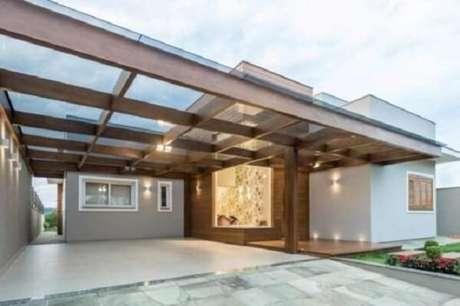 32. Cobertura de vidro para garagem acomoda vários carros – Fonte: Decorei