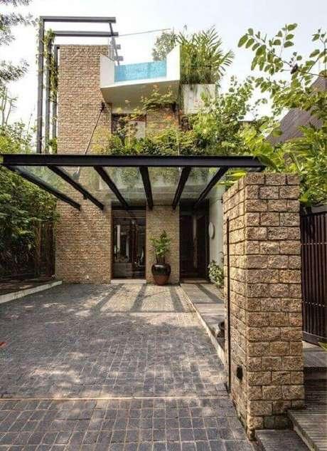 8. Cobertura de vidro para garagem e parede com pedras – Fonte: Revista Viva Decora