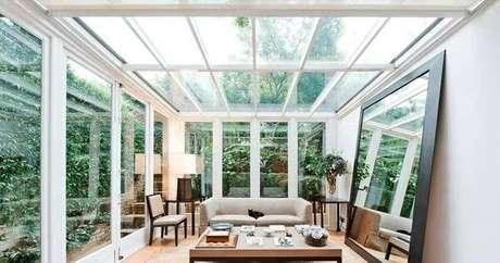 31. Ambiente iluminado com parede e teto de vidro – Fonte: Habitíssimo