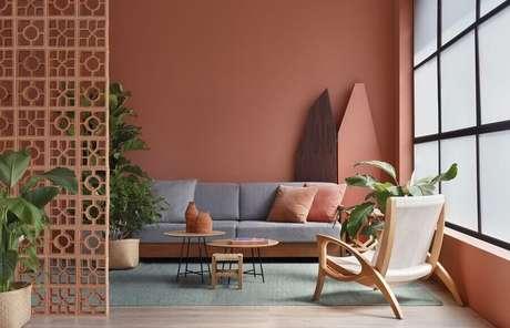 27. Cor terracota para decoração de sala de estar minimalista – Foto: Vitares Interiores