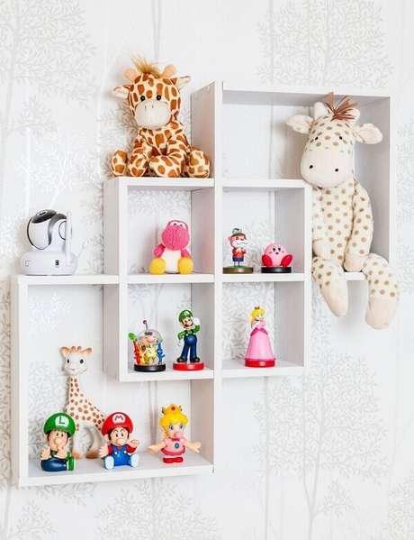 62- Os nichos para quarto de bebê organizam diversos brinquedos. Fonte: Andrea Bento