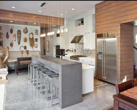 18. Cores para cozinha: O piso de concreto e os armários precisam combinar com as cores da cozinha.