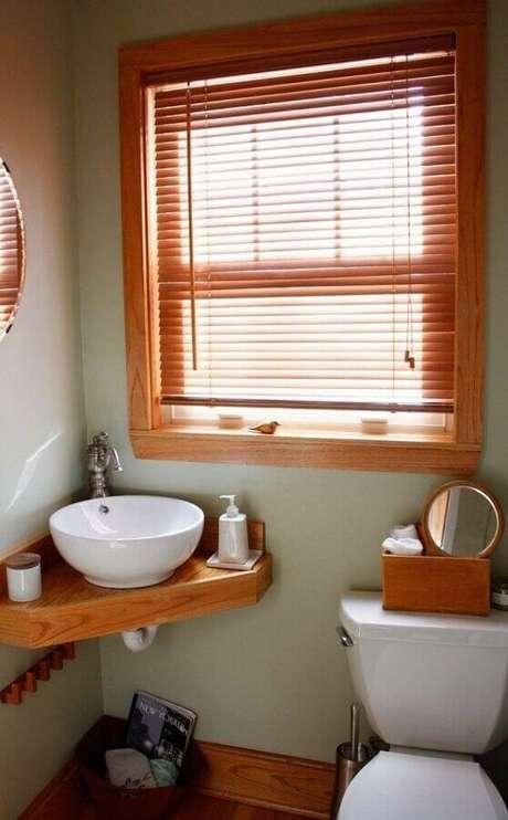 14. Decoração simples com pia de canto para banheiro pequeno – Foto: Apartment Therapy
