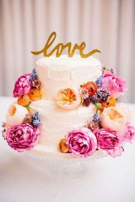 79- Bolo dois andares com flores coloridas. Fonte: Pinterest