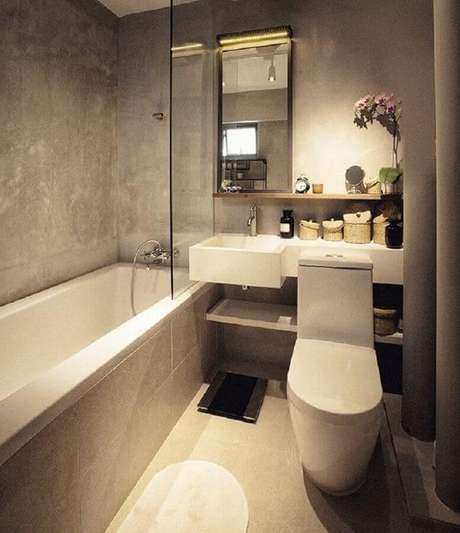 40. Pia para banheiro pequeno moderno decorado com cimento queimado – Foto: Webcomunica
