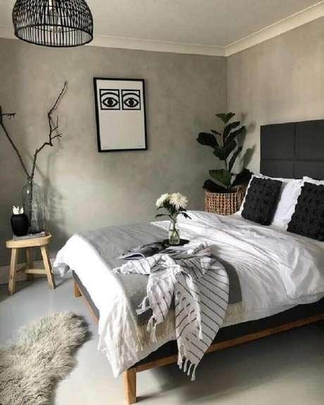 47. Modelos de quarto simples decorado com parede de cimento queimado e vaso grande de planta – Foto: Dicas de Mulher