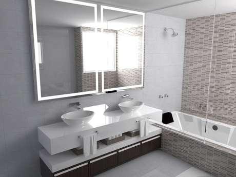 72. Banheiro com espelho iluminado com LED. Projeto de Fernando Lima
